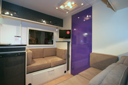 Lounge area with purple door into bedroom