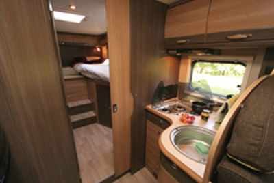 Rapido 666 motorhome looking rear kitchen