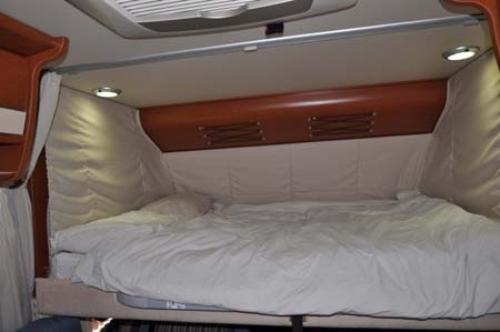 Luxury double bed inside the Hymer B544 motorhome