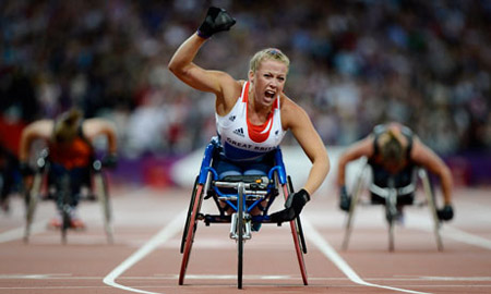 Hannah Cockroft of Great Britain celebrates winning the T34 200m final