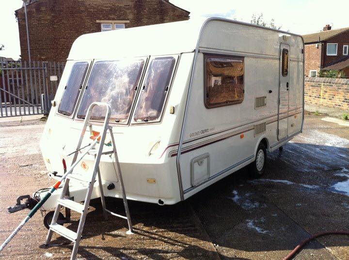 Caravan being cleaned with step ladder