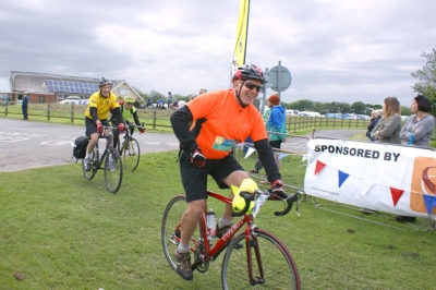 Peter Wilby crosses the Great Yorkshire Bike Ride finish line
