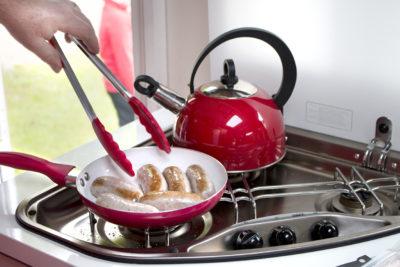 cooking breakfast sausages in pan